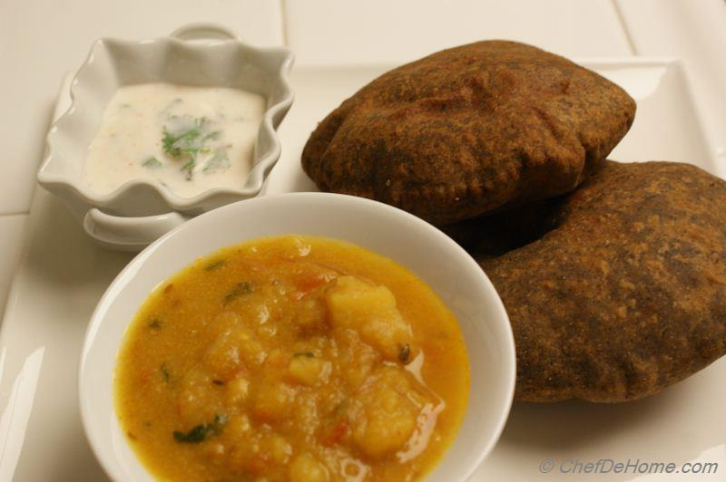 Serve Puffed Bread Or Poori with your choice of Potato Curry and ...