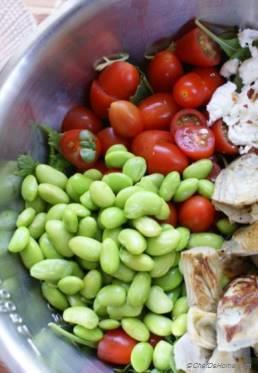 Cherry Tomatoes, Artichoke, Edamame Salad with Goat Cheese, Cilantro-Lime Vinaigrette