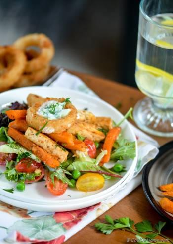 Step for Recipe - Tofu and Sweet Potato Fries Shawarma Salad Bowl with Onion Ring Croutons