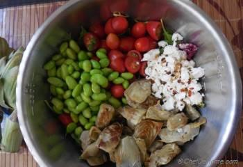 Step for Recipe - Cherry Tomatoes, Artichoke, Edamame Salad with Goat Cheese, Cilantro-Lime Vinaigrette