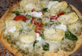Step for Recipe - Rustic Spinach, Artichokes and Basil Pesto Pizza