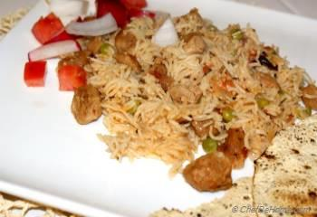 Step for Recipe - Indian Spicy Rice Pulav with Soy Nuggets, Tomatoes and Spices