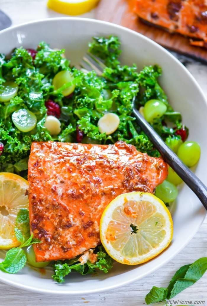 Healthy grilled Sweet and Spicy Chipotle Maple Glaze Salmon dinner with lite kale and grapes salad | chefdehome.com
