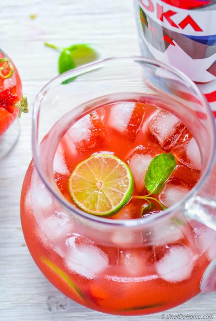 Pitcher filled of party style refreshing Strawberry Agua Fresca cocktail for 4th July Red White and Blue Theme Party | chefdehome.com