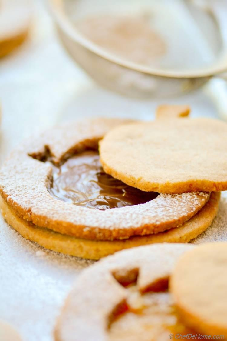 Make decorated Big Apple Linzer Cookies, and use Apple cut-outs as other set of cookies for special touch in gifts pouch!