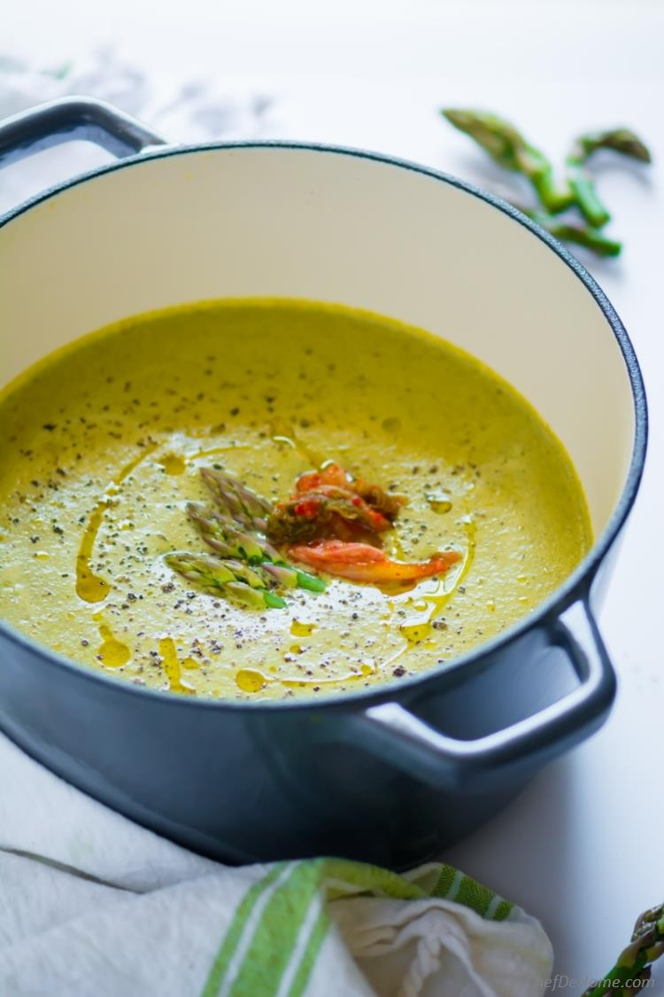 Creamy cream of asparagus soup without cream with spicy ginger and chili and coconut milk