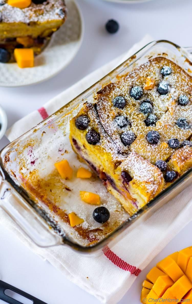 Juicy mango fresh blueberries in a comforting bread-pudding breakfast