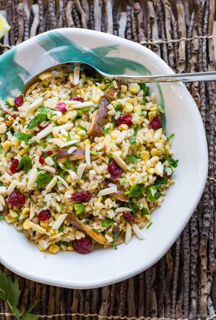 Brown Rice Salad loaded with healthy veggies and coated in a delicious lemon olive dressing | chefdehome.com
