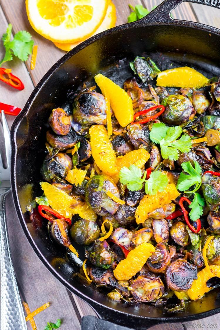 Charred Brussel Sprouts Cooked in Skillet with chilies orange and soy sauce