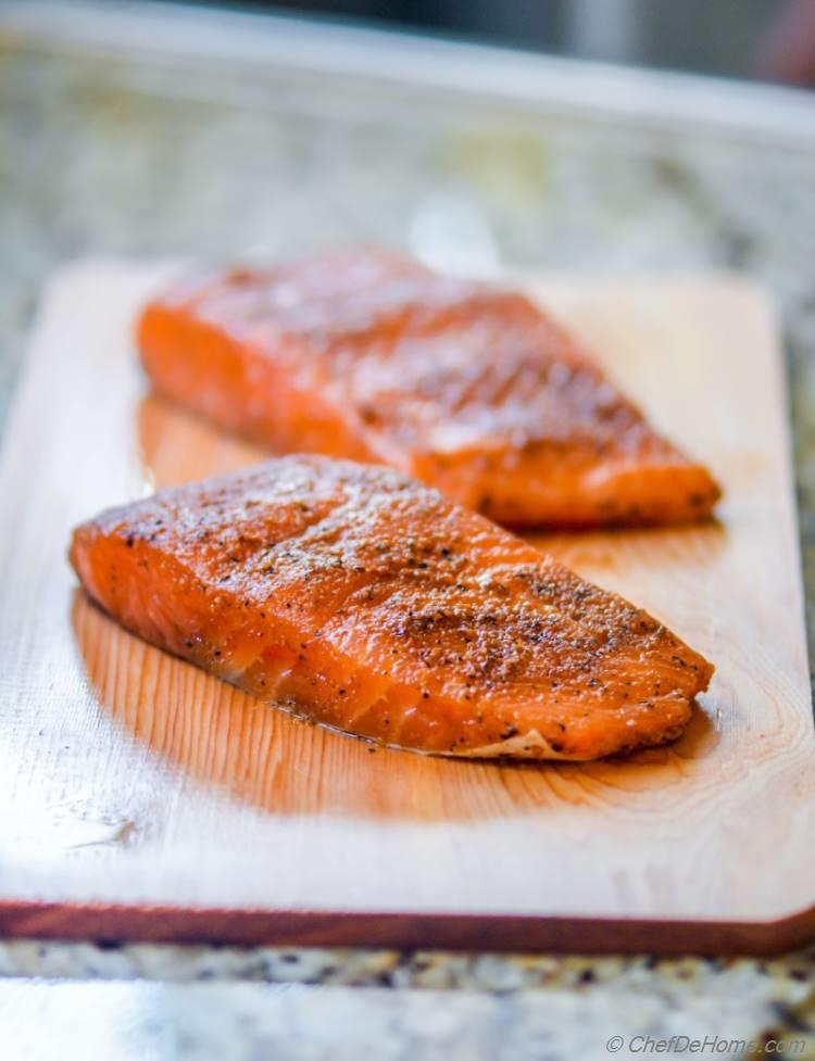 Dry Rubbed Salmon on a Cedar Plank ready to be grilled for a flavorful cedar aroma | chefdehome.com