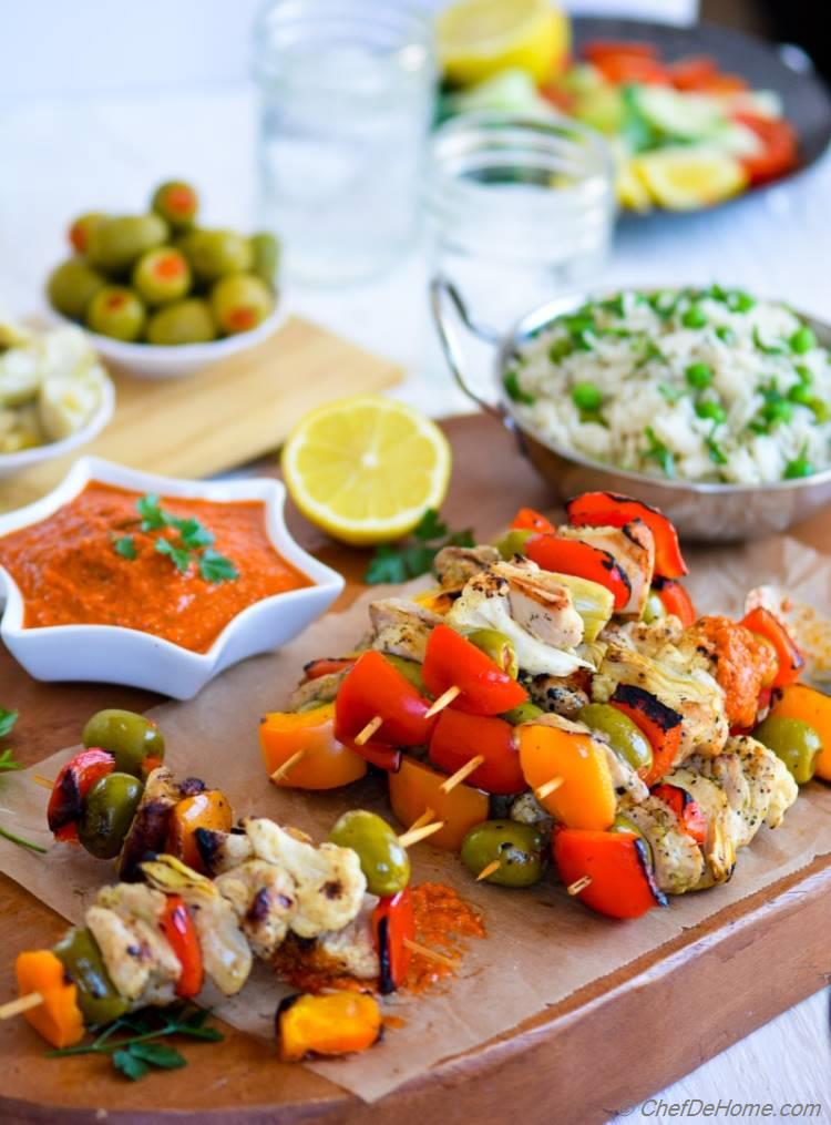 Grilled Chicken Kabobs with Romesco Sauce and Green Pea Pilaf | chefdehome.com