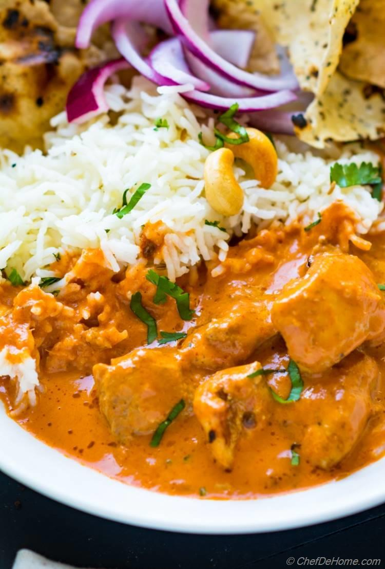 Creamy sauce of Tikka Masala with rice and pickle | chefdehome.com