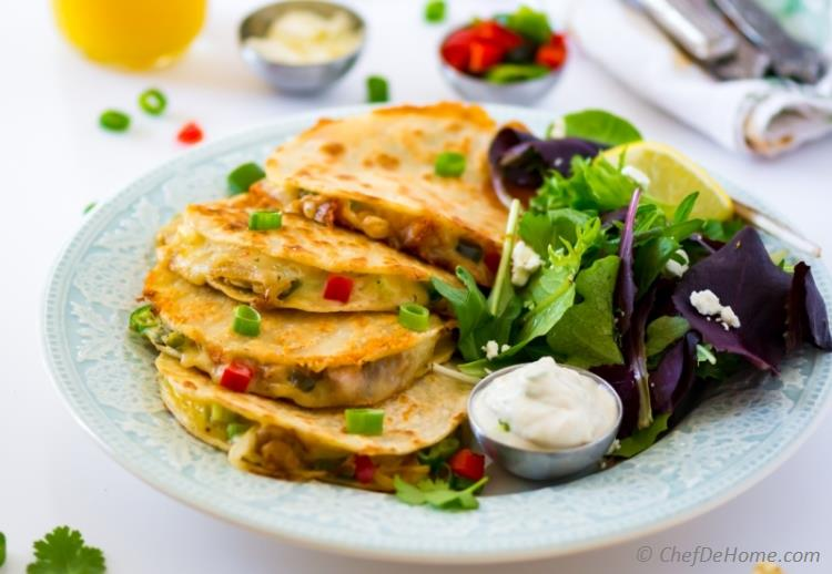 Chicken Quesadillas Loaded with spicy smoked grilled chicken and caramelized onions