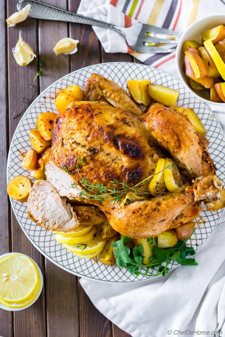 Perfect Roasted Whole Chicken with lemon thyme and potatoes