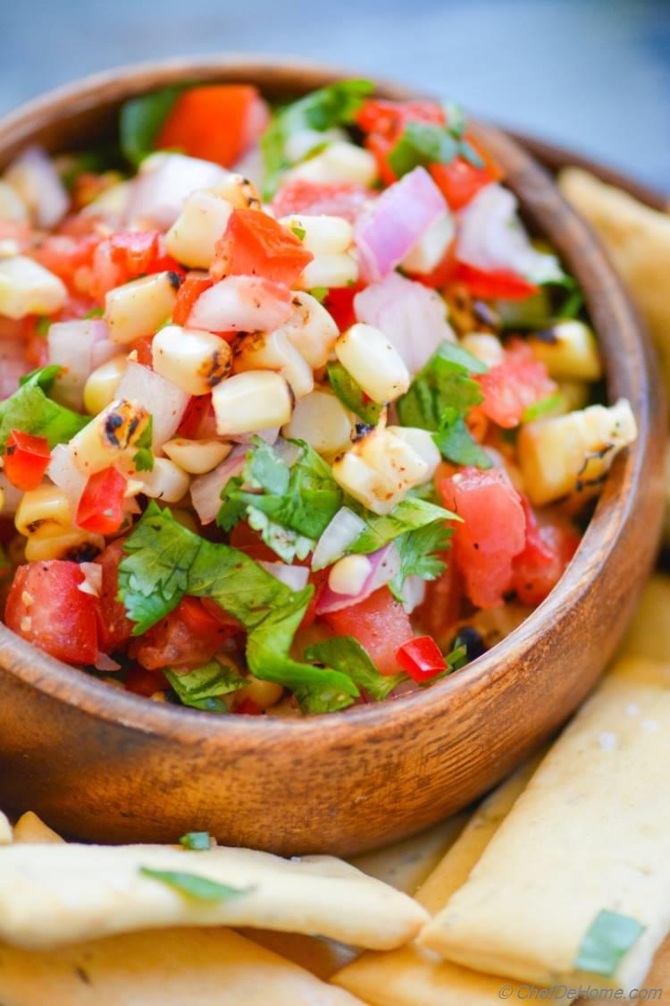 Tongue tantalizing Chili Lime and Roasted Corn Salsa, easy to assemble. No excuse for a great entertaining appetizer!
