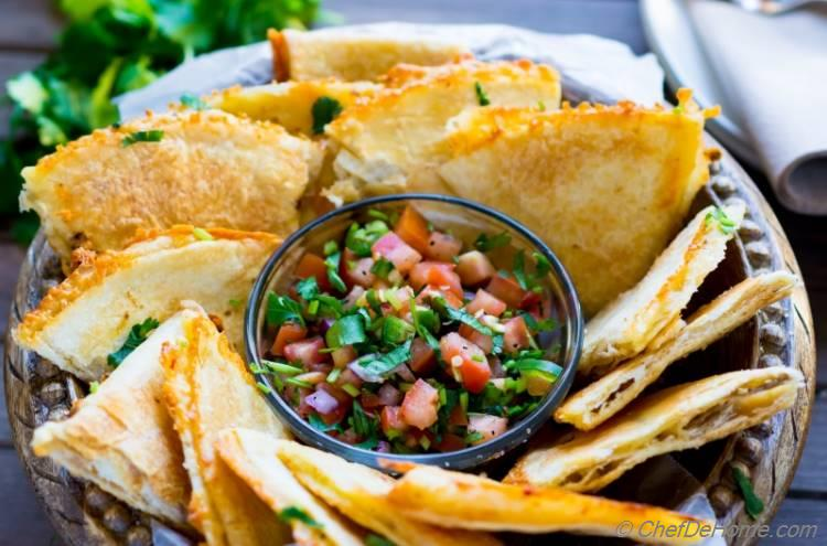 Baked Tortilla Chips with layer of cheese served with fresh homemade salsa | chefdehome.com