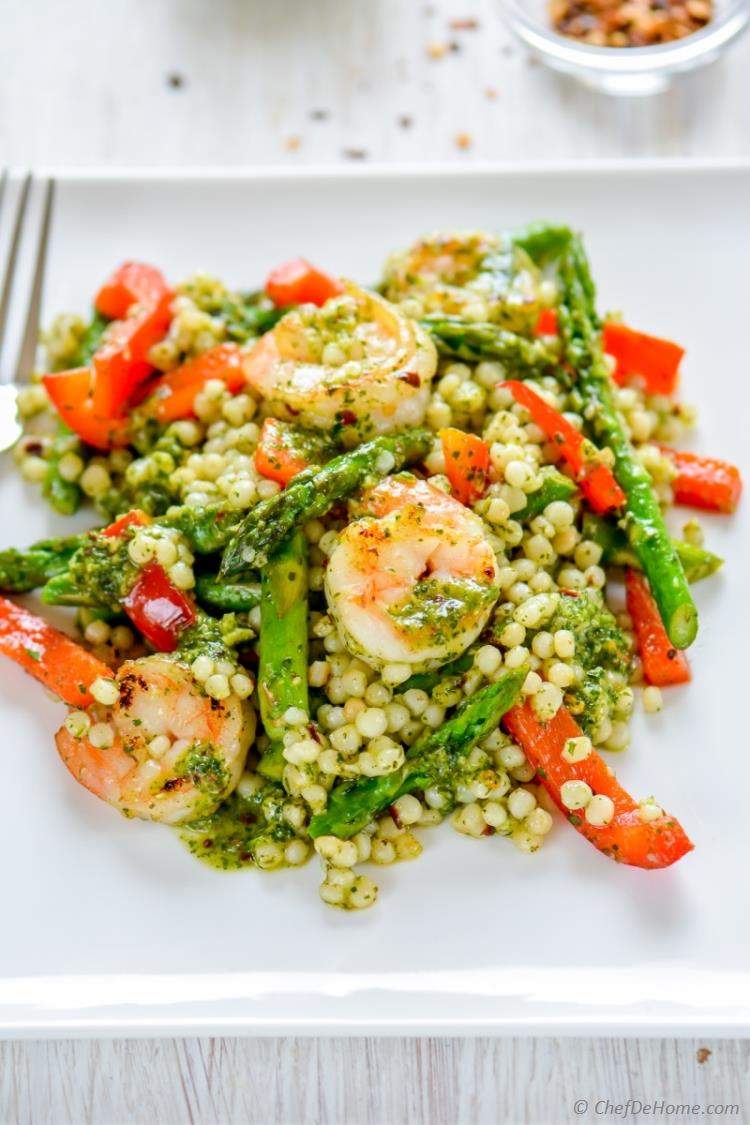 A lite dinner or delicious potluck salad loaded with lean grilled shrimp Chimichurri Sauce and nutty couscous pasta | chefdehome.com