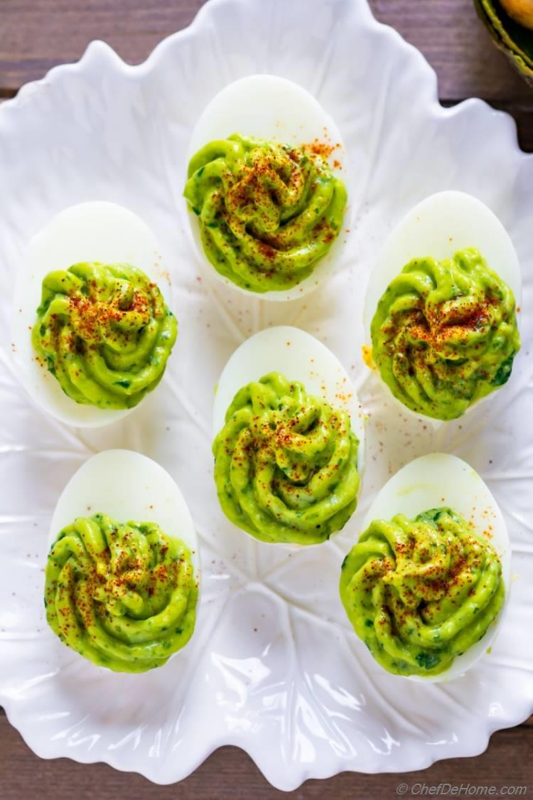 Platter of healthy and paleo deviled eggs for Easter brunch or spring parties. Also kids friendly with mild spicy with creamy taste of avocado