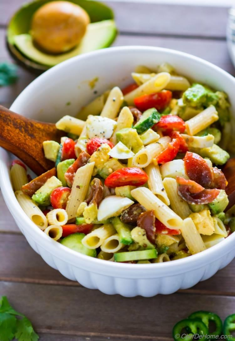 Deviled Egg Pasta Salad with healthy avocado tomato and cucumber