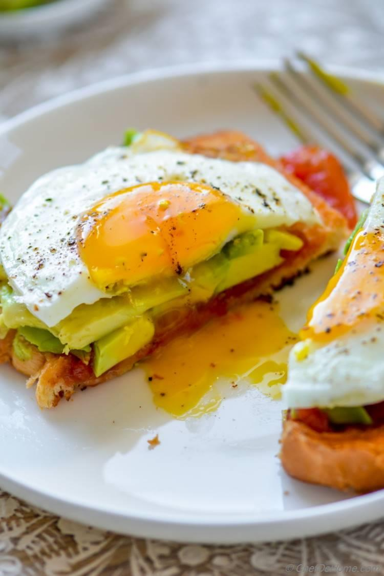 Sunny Side up Eggs with runny yolk and a toast | chefdehome.com