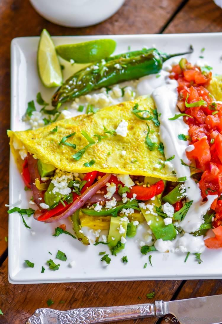 Chicken Breakfast Omelette with healthy fajita filling spicy salsa and avocado | chefdehome.com