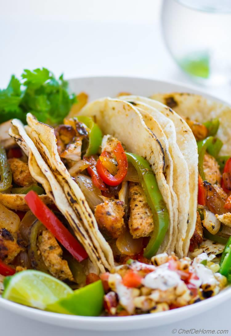Chicken Fajita with sauted peppers and onions and tortillas in tacos