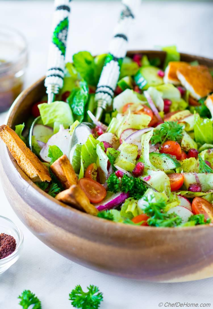 Bowl of Fattoush Salad with lettuce, cucumber, tomatoes, mint  and sumac dressing
