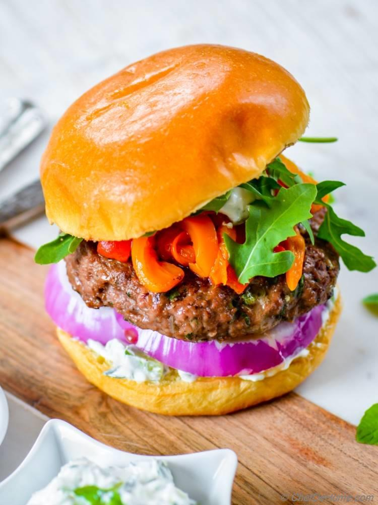 Greek Mint and Lamb Burgers with roasted red peppers cucumber yogurt sauce and arugula | chefdehome.com