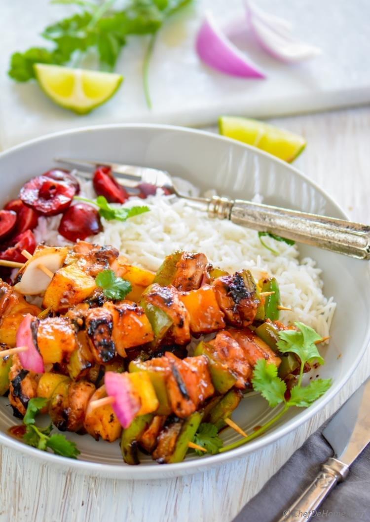 Grilled Hawaiian Chicken Skewers with pineapple marinade and side of rice and cherry salad | chefdehome.com
