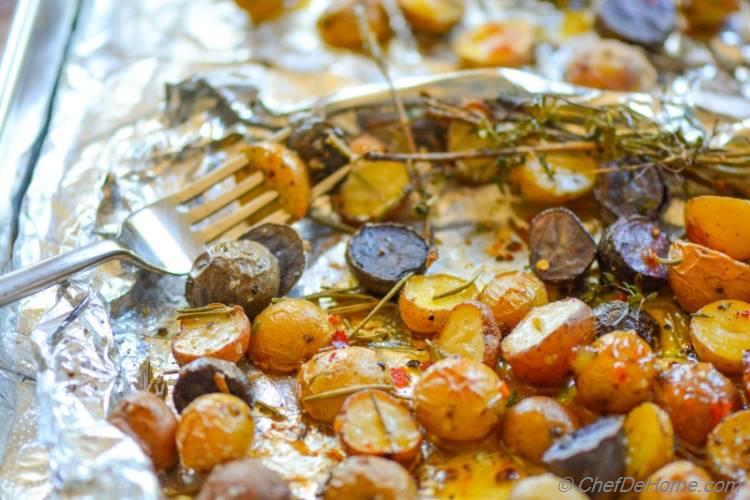 Herb Roasted Baby Rainbow Potatoes with Sweet and Spicy Mustard Dressing! An easy side dish with roasted or grilled meat dinner. Mix in some fresh tomatoes, onion, cilantro for Roasted Potato Salsa!