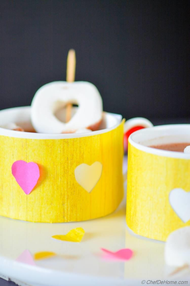 Valentine Day Hot Cocoa Served in Heart-Wrapped Cups with Heart Confetti