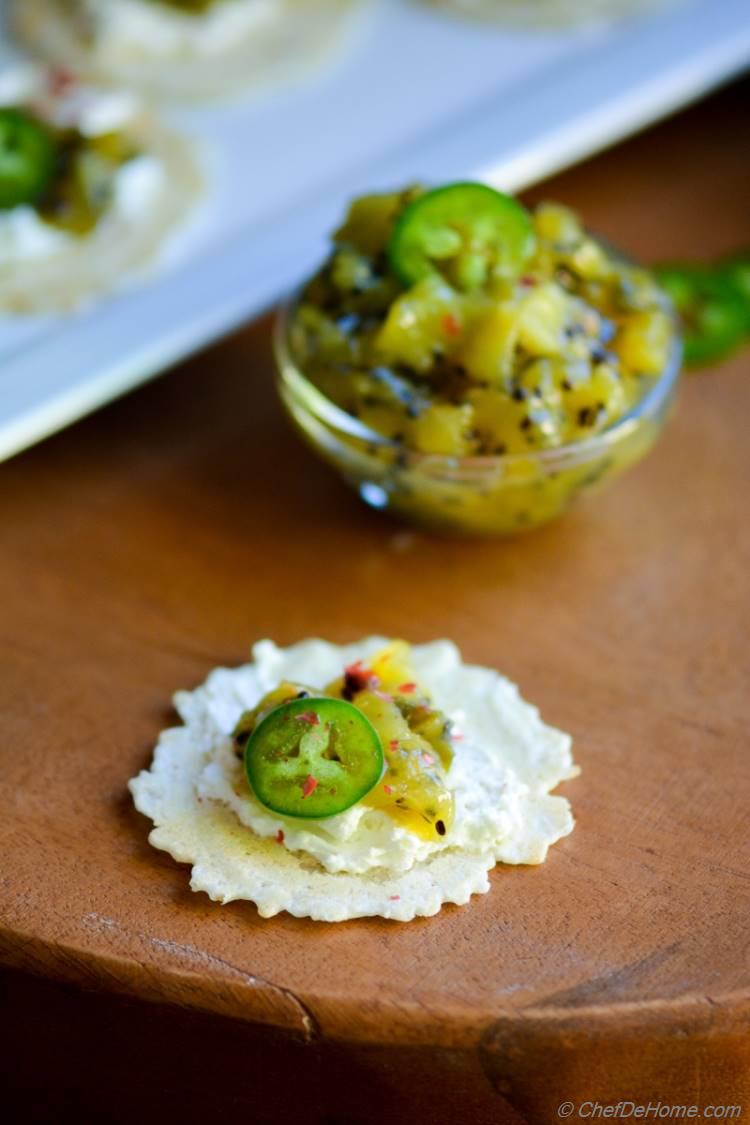 a 15 minute easy appetizer with homemade zesty Kiwi Chutney topped on gluten free rice crackers