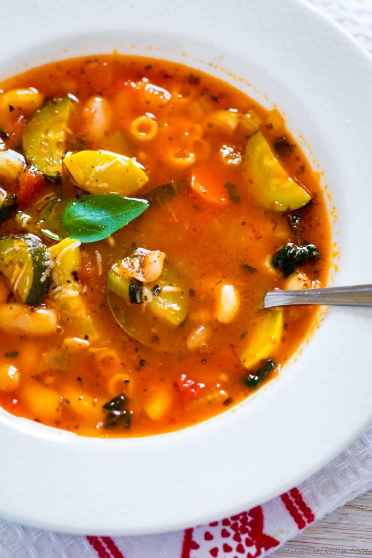 Bowl of Minestrone Soup with fresh basil and parmesan cheese
