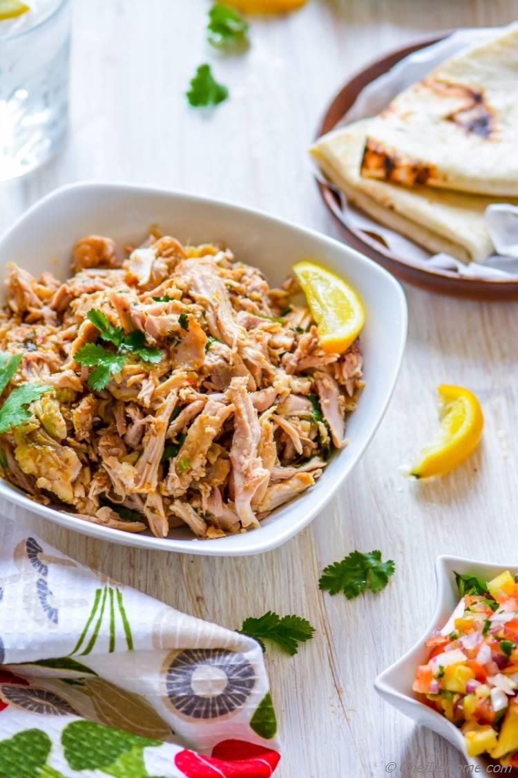 all prepared in slow cooker shredded Juicy Mojo Chicken perfect for lite summer dinner | chefdehome.com