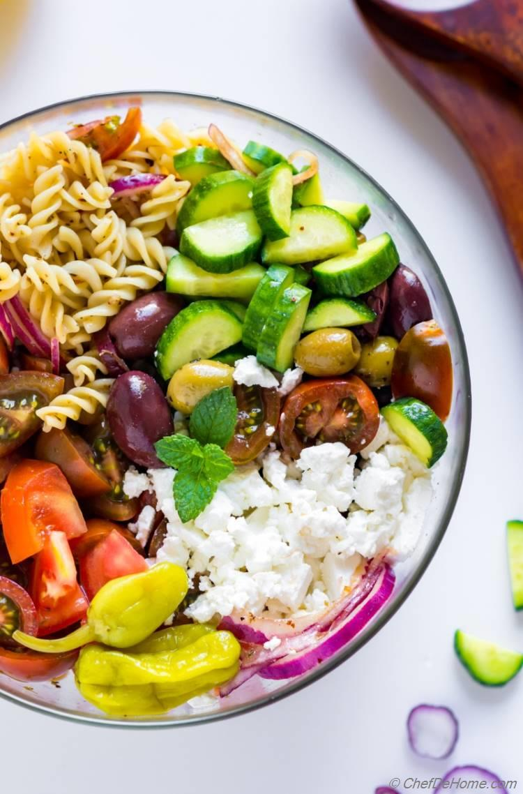 The best Greek Pasta Salad with feta cheese olives and zippy dressing