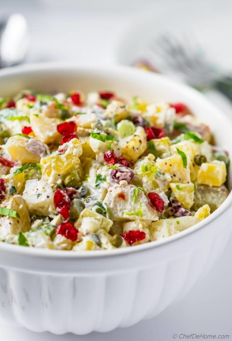 Potato salad with sweet cranberries, crunchy celery and no-mayo dressing | chefdehome.com