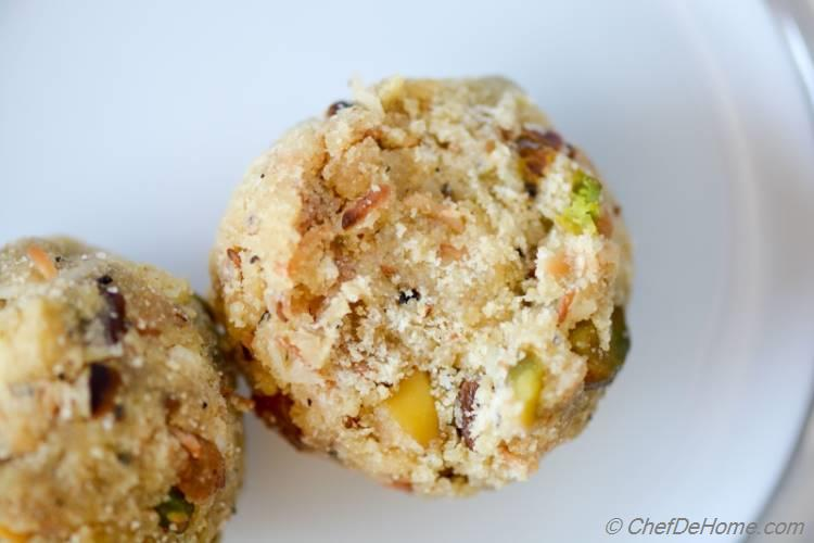 Rava (Semolina) Ladoo (truffles) have sweet, buttery bite with special surprise of crunchy pistachio nuts and savory plum golden raisins. Special favorite of kids, these sweets often disappear from your kitchen sooner than you can imagine!