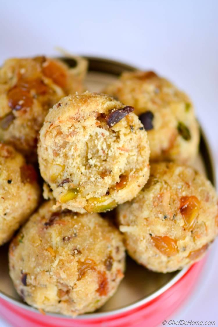 Indian Rava (Semolina) Ladoo, a special occasion sweet treat! These ladoo have sweet, buttery bite with special surprise of crunchy pistachio nuts and savory plum golden raisins. Great for gifting during holidays and festivals, these sweet treats are good filling snack. 1-2 ladoo can keep you full much longer and give great energy for heavy workouts.!