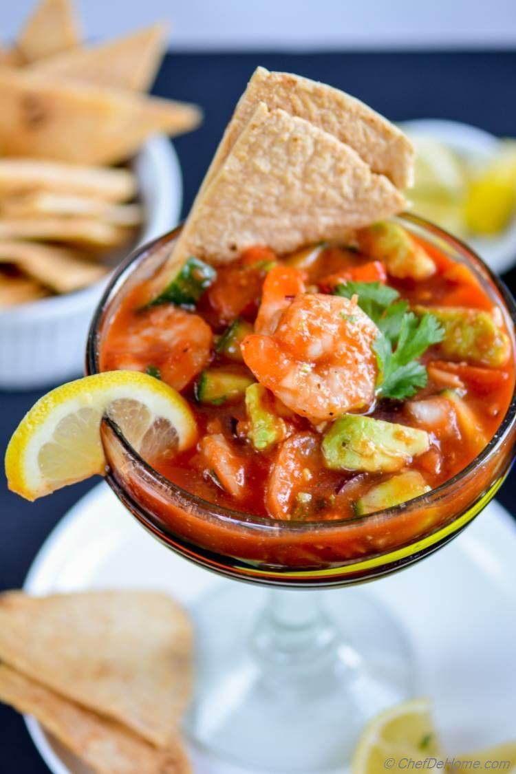 Mexican Shrimp Cocktail loaded with fresh avocado cucumber tomatoes shrimp and zesty bloody mary sauce | chefdehome.com