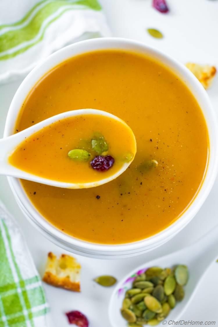 Creamy Roasted Butternut Squash Soup in bowl with spoon