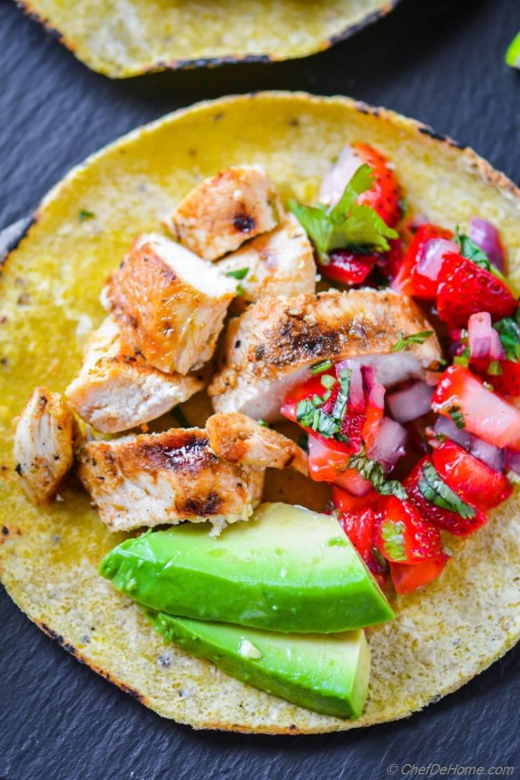 Close look at delicious Grilled Chicken Tacos with strawberry avocado salsa | chefdehome.com