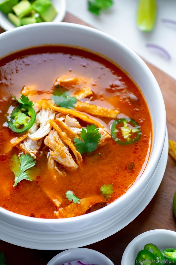 Bowl of Chicken Tortilla Soup with Tortilla Strips and Chicken Breast