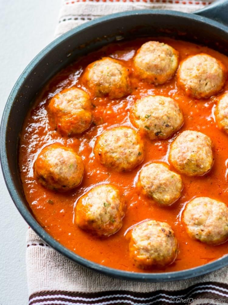 Turkey meatball simmering in marinara sauce | chefdehome.com