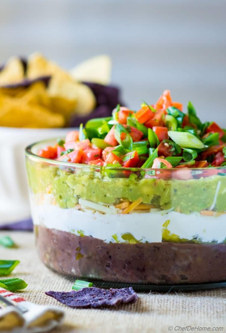 Easy game day appetizer of 7 Layer Mexican Dip with fresh guacamole refried beans and sour cream | chefdehome.com